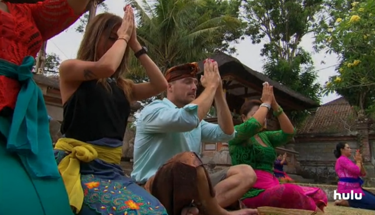 Kaitlyn and Chris in salutations on their Bali date
